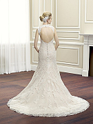 Moonlight Couture H1263 romantic lace wedding dresses with sleeves and beading make a statement.