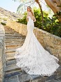 Moonlight Couture H1361B romantic lace wedding dresses with sleeves and beading make a statement.