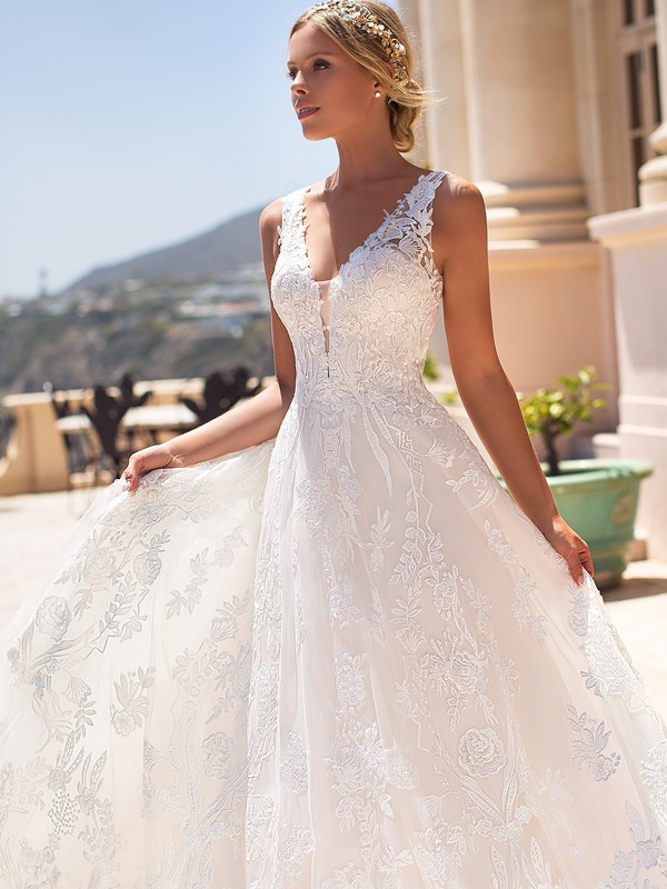 Moonlight Couture H1376 full ball gown wedding dress with bold lace details and straps