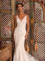Moonlight Couture H1396 lightly beaded re-embroidered lace mermaid bridal gown with deep V-neckline