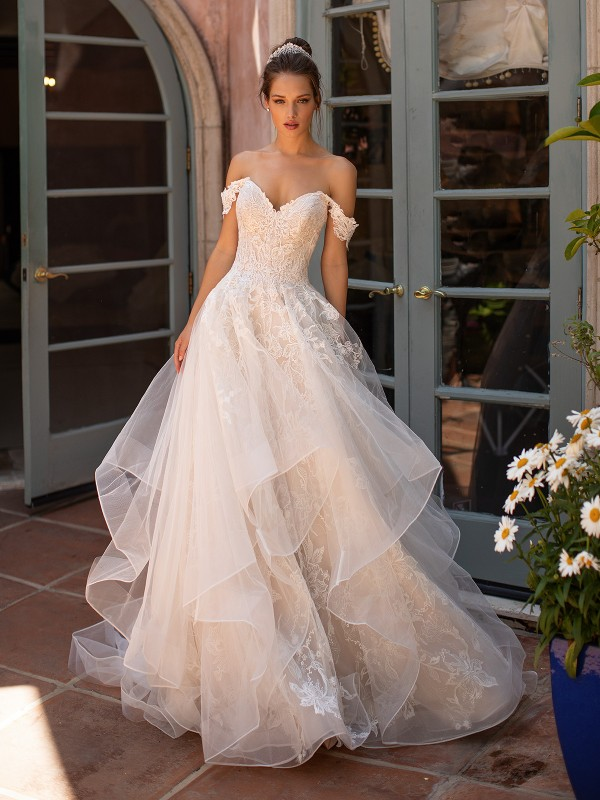 Moonlight Couture H1428 wedding dress with tulle cascade skirt and swag sleeves