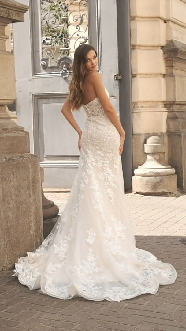 Moonlight Couture H1461 Illusion Open Back Beaded Lace Wedding Gown with Covered Buttons Along Zipper