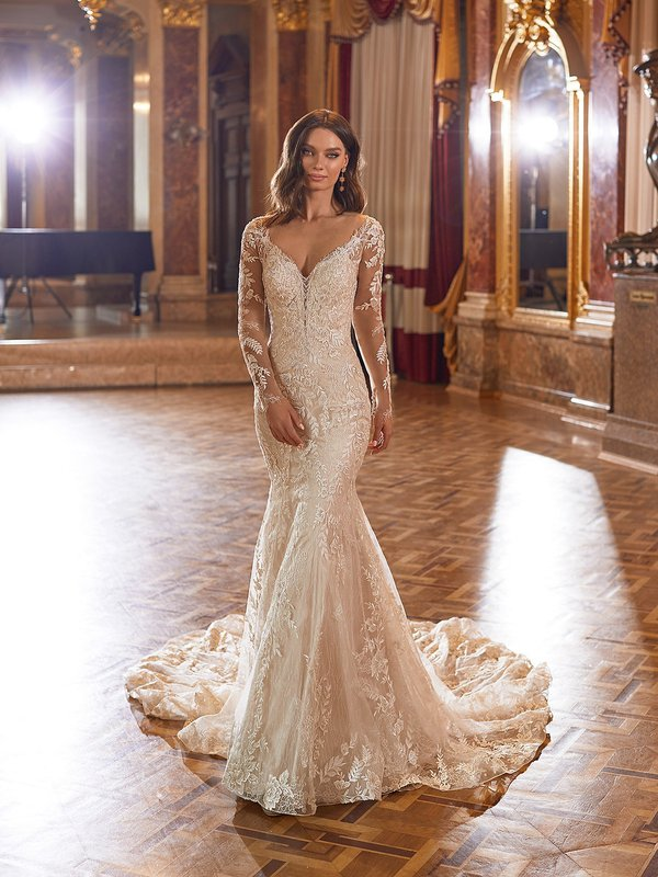 Moonlight Couture H1479 romantic lace wedding dresses with sleeves and beading make a statement.