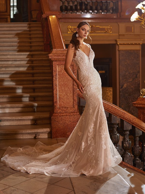 Moonlight Couture H1480 romantic lace wedding dresses with sleeves and beading make a statement.