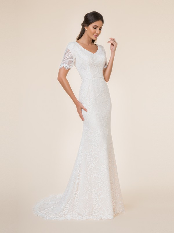 Modest mermaid wedding dress with wide v-neck, embroidered lace fabric, beaded band at waist and sweep train