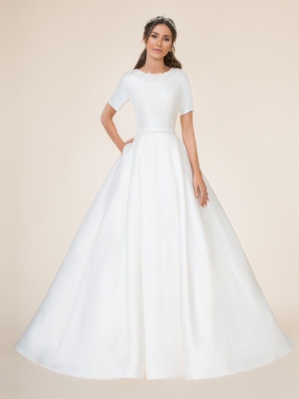 Modest ball gown with bateau neckline and short sleeves with pockets at side seam