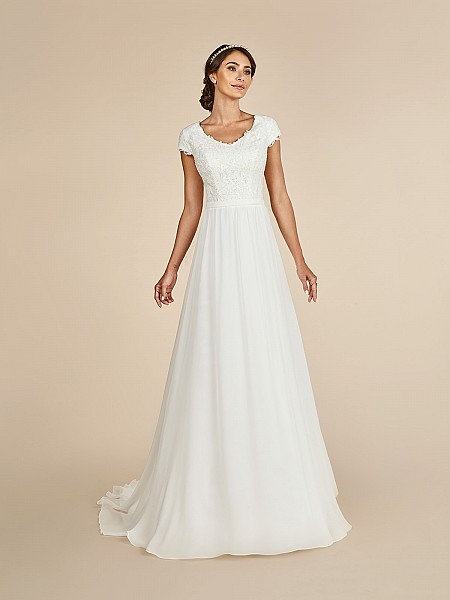 Elegant A-line dress with wide v-neck, lined cap sleeves,  re-embroidered lace appliques and couture band at waist