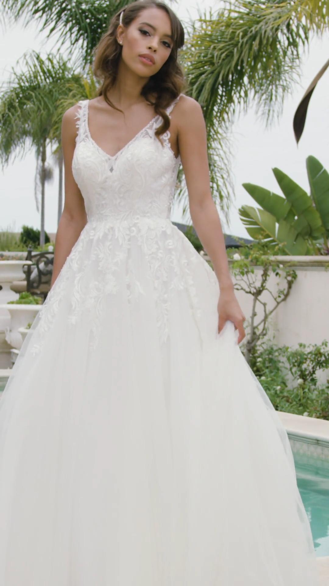 Moonlight Tango T930 V-neck A-line wedding dress with lace bodice and beaded trim necklines and buttons along illusion back